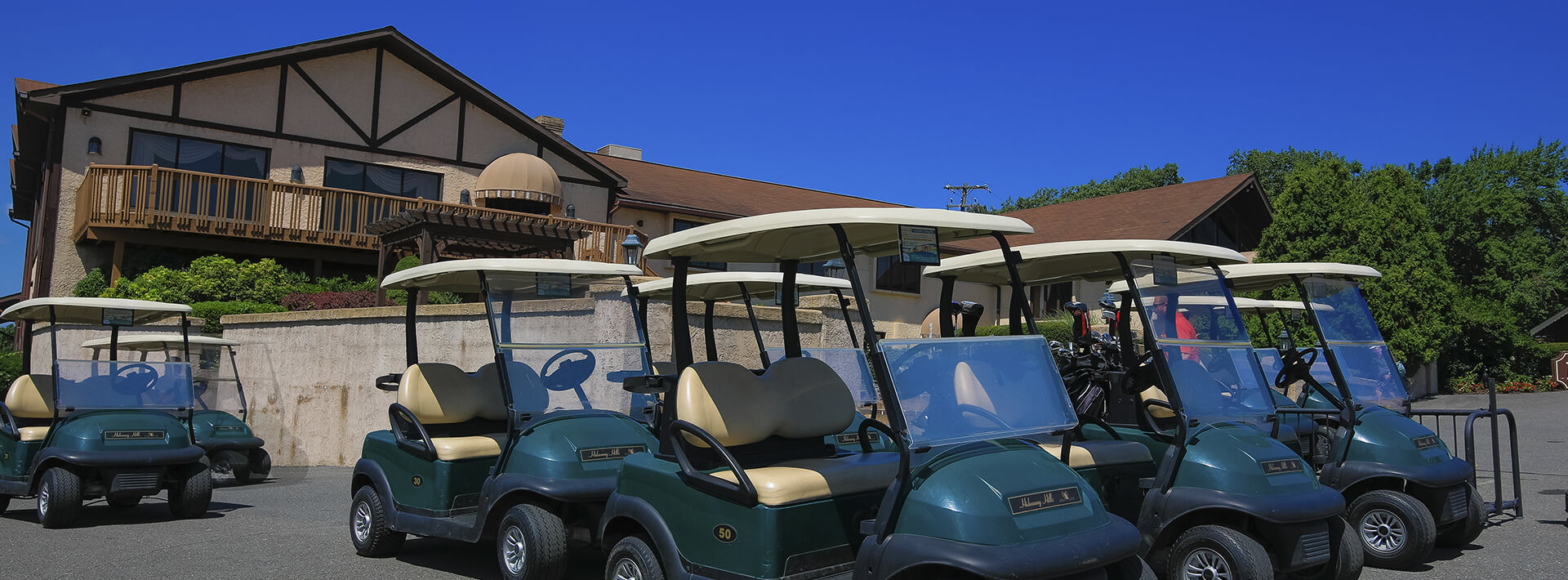 A photo of the Hideaway Hills golf club with parked golf carts